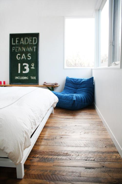 ? wooden floor, sign & blue cushion - morning breeze