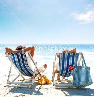 View of a couple sitting on deck | Stock Photo | iStock