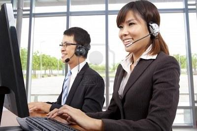 Smiling Customer Service Representative In Modern Office With.. Royalty Free Stock Photo, Pictures, Images And Stock Photography. Image 8481429.