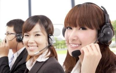 Similing Business Customer Service Team On The Phone Royalty Free Stock Photo, Pictures, Images And Stock Photography. Image 8915335.