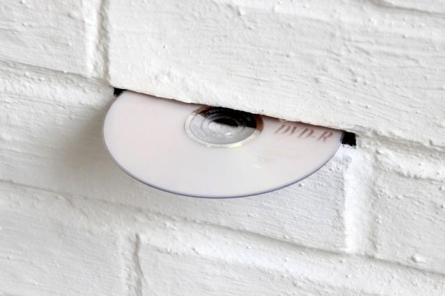 """DVD Drop Dead"" Features A DVD Player Hidden In A Wall 