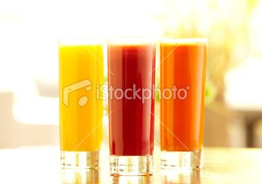 Three tall glasses of orange, carrot and vegetable juice | Stock Photo | iStock