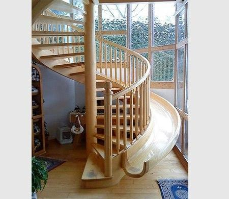 Wooden spiral stair case with a slide.