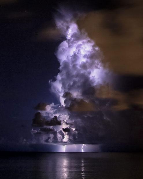 Lightning lighting up a huge cloud - Imgur
