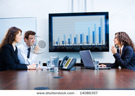 Happy Young Businesspeople Having Meeting In Boardroom At Office In Front Of A Huge Plasma Tv Screen, Indoor, Smiling. Stock Photo 14086357 : Shutterstock
