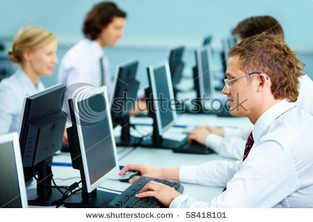 Smart Businesspeople Typing At Workplaces In Computer Room Stock Photo 58418101 : Shutterstock