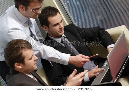Three Business Men Working Together On Laptop In The Office. One Is Standing Two Are Sitting On Leather Sofa - Close Up Stock Photo 2317899 : Shutterstock