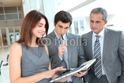 Photo: Business team meeting in hall © goodluz #28821732