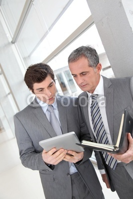 Photo: Businessmen meeting in hall with agenda © goodluz #28821498