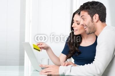 Photo: Surpised couple internet shopping © Rido #30205786