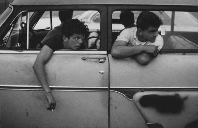 The Age of Adolescence (guys leaning out of car) by Joseph Sterling presented by Stephen Daiter Gallery