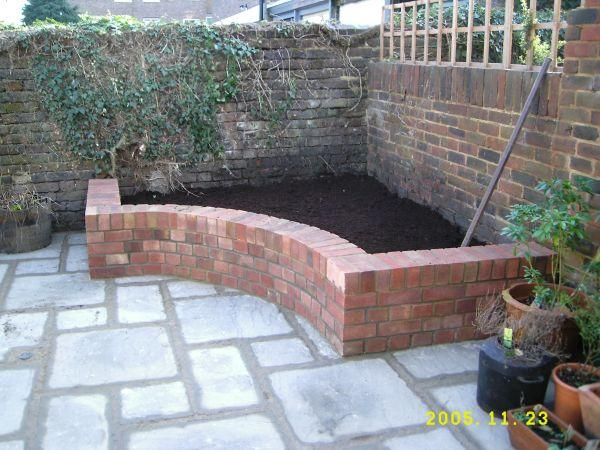 Indian stone Patio, brick raised flower beds project in Tonbridge, Kent by WhitesLandscaping.co.uk