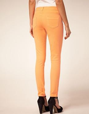 ASOS | ASOS PETITE Exclusive Pale Orange Skinny Jeans at ASOS