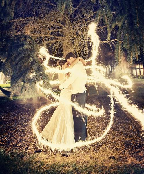 Wedding Bells / It's a long exposure shot with sparklers All they had to do was stand there very still and someone else ran around them with a sparkler. it's like a fairy tale!