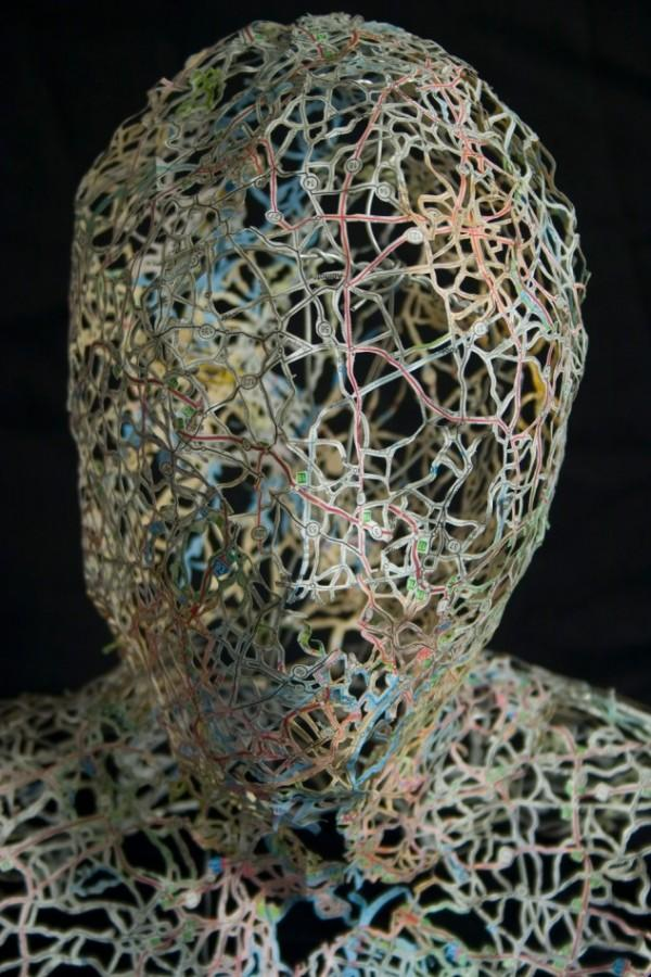 Head sculpture made from intricately cut street maps | Colossal