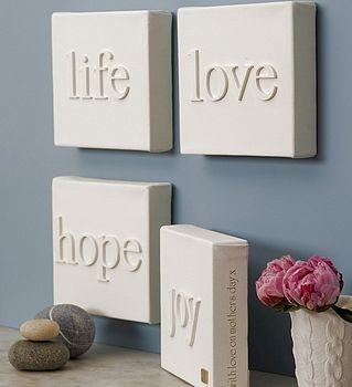 DIY / canvas + wood letters, then paint the whole thing. simplicity.