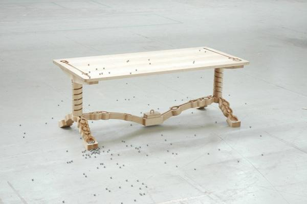 Marbelous, a wooden table with built-in marble tracks | Colossal