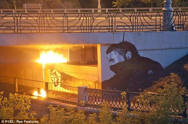 Codename Bankski: The 'Russian Banksy' brings guerilla art to Moscow | Mail Online