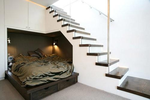 monochrome spaces. / interesting- bed under the stairs