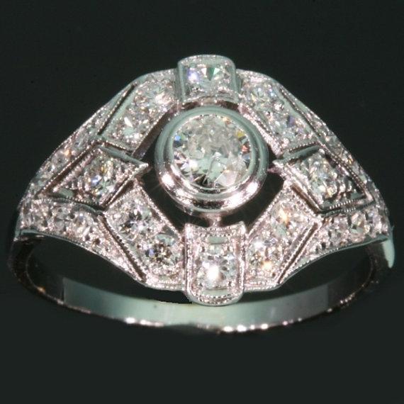 Vintage platinum diamonds engagement ring by adinantiquejewellery
