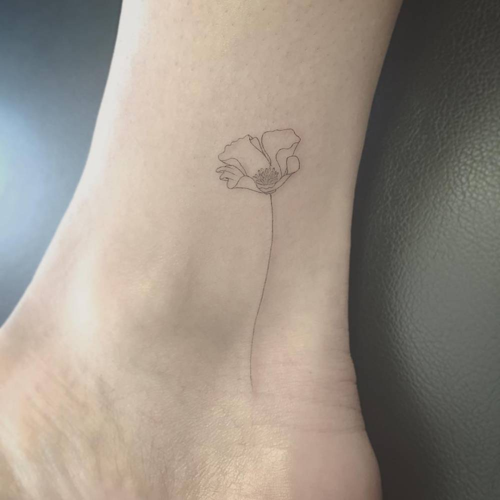 Fine line style poppy on the ankle.Done by East