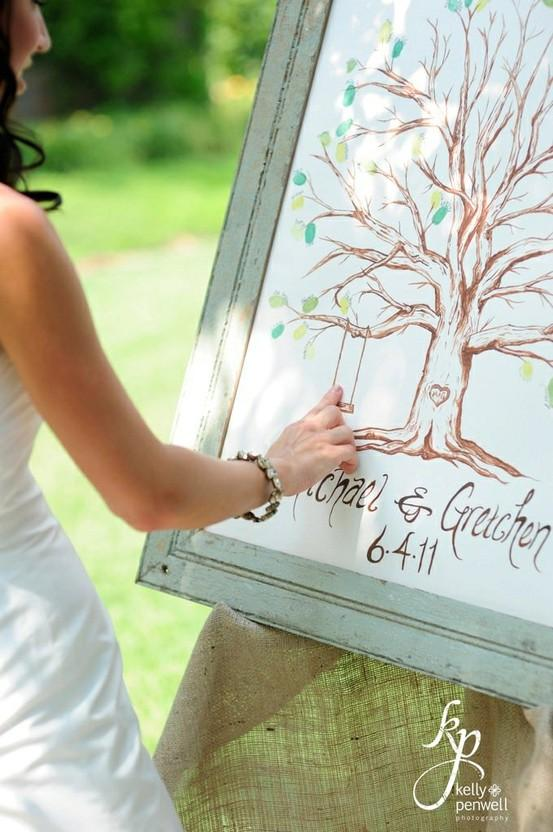 Jessica + Jonathan Wedding Inspiration / Creative and beautiful idea for a guestbook. When we arrived, we left our fingerprint on the tree and signed our names. At the end of the ceremony, the bride and groomed added their fingerprints on the swing hanging from the tree.