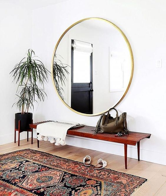 This huge round mirror is the perfect addition to your entryway or hallway. Paired with a teak wood bench & bamboo plant, this mirror slays! | Pinterest