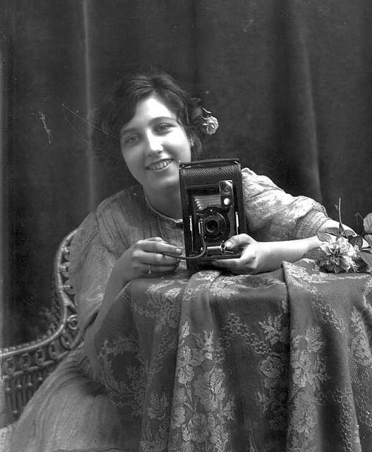 Young smiling woman, holding a camera | Flickr - Photo Sharing!