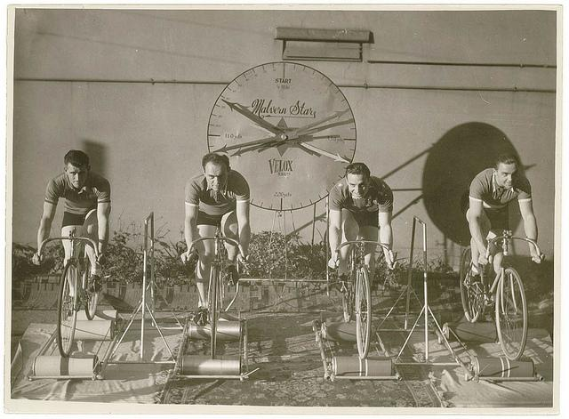 Four cyclists on speed bicycles on rollers time trials to promote Malvern Star: from left, Lennie Rogers, Bill Moritz, .. ?, .. ?], by Sam hood | Flickr - Photo Sharing!