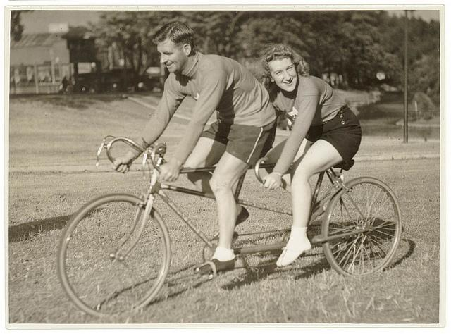 Oppy (Hubert Opperman) and woman, possibly Edna Sayers, on tandem bicycle, by Sam Hood | Flickr - Photo Sharing!