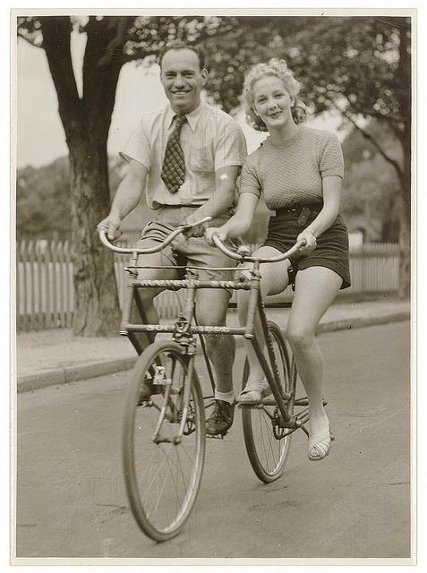 Man and woman on a Malvern Star abreast tandem bicycle, c. 1930s, by Sam Hood | Flickr - Photo Sharing!