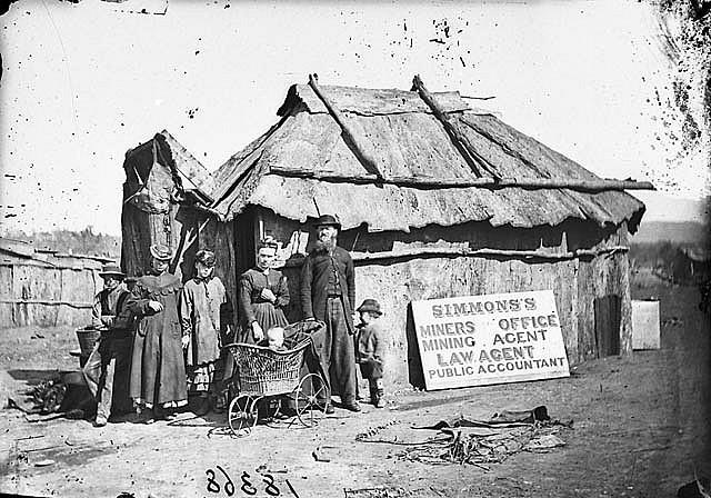 Simmons' (miners' office, mining agent, law agent and public accountant) and family outside his bark hut, Gulgong area, 1871-1875 / American & Australasian Photographic Company | Flickr - Photo Sharing!