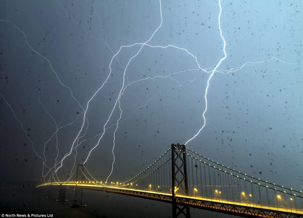 Once-in-a-lifetime picture of lightning striking San Francisco's Bay Bridge | Mail Online