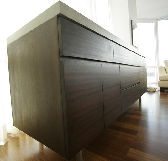 Custom designed mahogany cabinet supported by stainless steel legs and a cast concrete top with clear crushed glass | Oso Industries