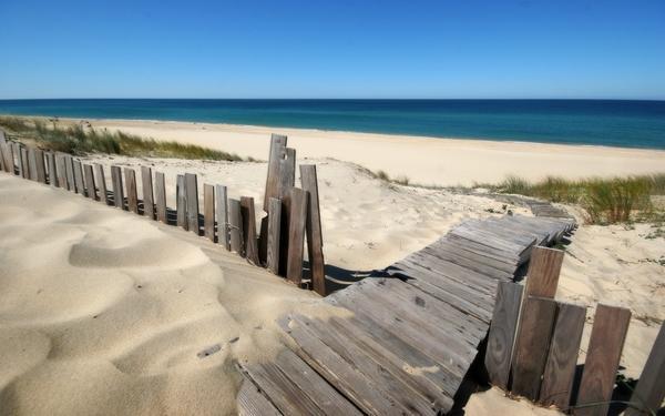 landscapes,water water landscapes beach sand sea fences blue sky 1920x1200 wallpaper – Beaches Wallpaper – Free Desktop Wallpaper