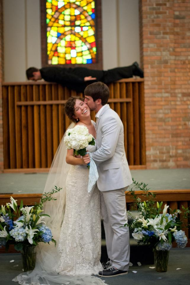 My friend's brother's wedding photo...with their pastor in the background. - Imgur