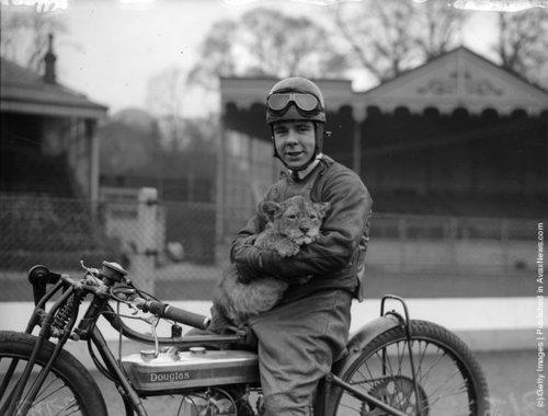 Vintage Photography | Motorcyclist Triss Sharp and his pet lion cub...