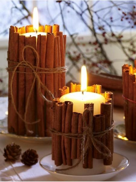 DIY & Crafts / Tie cinnamon sticks around your candles. the heated cinnamon makes your house smell amazing. good holiday gift idea too.