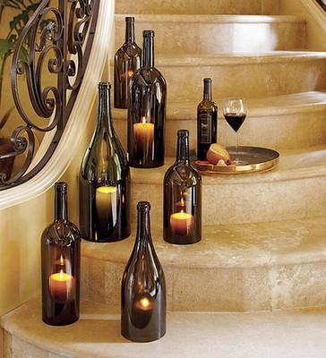 Like / Cut the bottoms off of wine bottles and create beautiful candle displays!